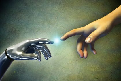 Human hand touching an android hand. Digital